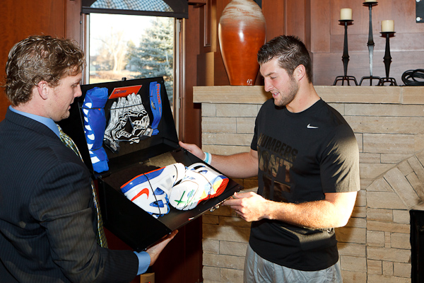 Tebow receiving his Nike Boom Box